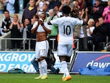 Swansea player Wayne Routledge celebrates with Wilfried Bony after scoring the second goal during the Barclays Premier League match between Swansea City and West Bromwich Albion at Liberty Stadium on August 30, 2014