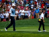 Tiger Woods of the United States smiles alongside golf instructor Sean Foley during a practice round prior to the start of the 96th PGA Championship at Valhalla Golf Club on August 6, 2014