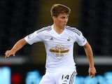 Swansea player Tom Carroll in action during the Capital One Cup Second Round match between Swansea City and Rotherham United at Liberty Stadium on August 26, 2014