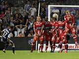 Toulouse's French Moroccan midfielder Adrien Regattin scores a goal during the French L1 football match Toulouse (TFC) against Evian Thonon Gaillard (ETGFC) on August 30, 2014