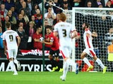 Will Grigg of Milton Keynes Dons celebrates scoring the opening goal during the Capital One Cup Second Round match against Manchester United on August 26, 2014