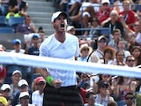 Andy Murray of Great Britian celebrates a shot while playing Jo-Wilfried Tsonga of France during their 2014 US Open men's singles match at the USTA Billie Jean King National Tennis Center September 1, 2014