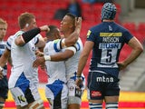 Anthony Watson of Bath Rugby celebrates with team mates after scoring his teams first try as Michael Paterson of Sale looks on during the Aviva Premiership match on September 6, 2014