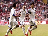 Armenia's midfielder Gevorg Ghazaryan, Armenia's defender Levon Hayrapetyan and Armenia's midfielder Henrikh Mkhitaryan celebrate scoring during the UEFA Euro 2016 Group I qualifying match of Denmark vs Armenia on September 7, 2014
