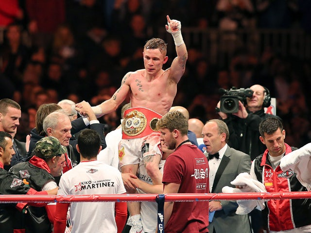 Britain's Carl Frampton celebrates after defeating Spain's Kiko Martinez during an IBF super-bantamweight title boxing match in Belfast's Titanic Quarter in Northern Ireland, on September 6, 2014