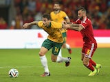 Chris Herd of Australia is challenged by Steven Defour during International friendly match between Belgium and Australia at Stade de Sclessin on September 4, 2014