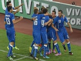 Ciro Immobile of Italy celebrates with his teammates after scoring the opening goal during the international friendly match against Netherlands on September 4, 2014