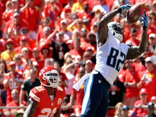 Delanie Walker #82 of the Tennessee Titans catches a pass for a touchdown against Kansas City Chiefs on September 7, 2014