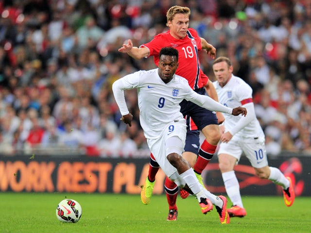 England's Daniel Sturridge vies with Norway's Ruben Yttergard Jenssen during the international friendly football match between England and Norway at Wembley Stadium in north London on September 3, 2014