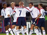 England's captain David Beckham celebrates the opening goal scored by Frank Lampard at the Ernst-Happel stadium in Vienna 04 September 2004