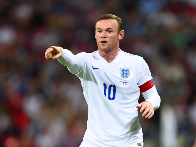 Wayne Rooney of England gestures during the International friendly match between England and Norway at Wembley Stadium on September 3, 2014