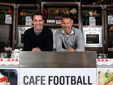 Gary Neville and Ryan Giggs pose in the cafe of new venture Hotel Football