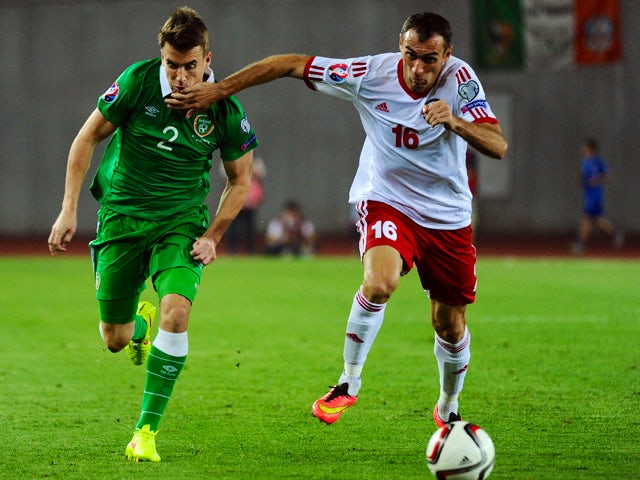 Georgia's David Kvirkvelia vies with Ireland's Seamus Coleman during their Euro Cup 2016 qualifying football match Georgia vs Ireland in Tbilisi on September 7, 2014