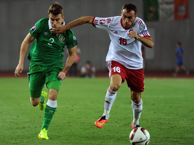 Georgia's David Kvirkvelia vies with Ireland's Seamus Coleman during their Euro Cup 2016 qualifying football match Georgia vs Ireland in Tbilisi on September 7, 2014