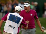 Ian Poulter of Europe celebrates with his caddie Terry Mundy after making birdie on day two of the 2012 Ryder Cup at Medinah on September 29, 2012