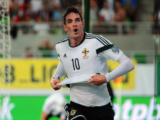 Northern Ireland's forward Kyle Lafferty (C) celebrates scoring against Hungary during a qualification match for EURO 2016 between Hungary and Northern Ireland on September 7, 2014