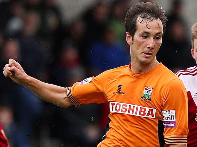 Luisma Villa of Barnet (C) in action during the Skrill Conference Premier match between Barnet and Wrexham AFC at The Hive Stadium on October 13, 2013