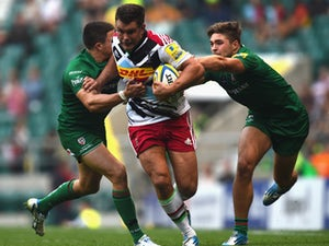 Nick Easter of Harlequins is tackled by Tom Fowlie of London Irish during the Aviva Premiership match between London Irish and Harlequins at Twickenham Stadium on September 6, 2014