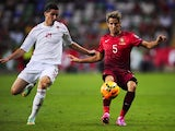 Albania's forward Odise Roshi (L) vies with Portugal's defender Fabio Coentrao during the UEFA Euro 2016 qualifying football match on September 7, 2014