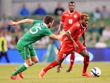 Republic of Ireland's Robbie Brady vies with Oman's Saad Al-Mukhaini during the international friendly football match between Republic of Ireland and Oman at Aviva Stadium in Dublin on September 3, 2014