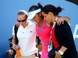 Shuai Peng of China is tended to by trainers after getting injured while playing against Caroline Wozniacki of Denmark during their women's singles semifinal match on Day Twelve of the 2014 US Open at the USTA Billie Jean King National Tennis Center on Se