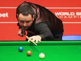 Stephen Maguire of Scotland in action against Ryan Day of Wales during day one of the The Dafabet World Snooker Championship at Crucible Theatre on April 19, 2014