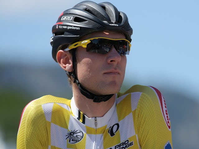 Tejay van Garderen of the United States riding for the BMC Racing Team arrives at the start in the overall race leader's yellow jersey on August 24, 2014