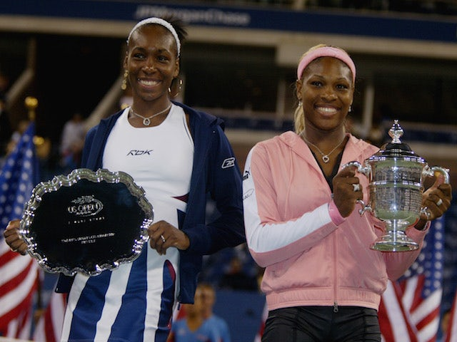 Venus & Serena Williams pose with their trophy after the finals at the US Open September 7, 2002