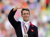 Bronze medalist British William Fox-Pitt celebrates during the podium ceremony for the Jumping event of the 2014 FEI World Equestrian Games, on August 31, 2014