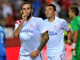 Sevilla's midfielder Aleix Vidal celebrates after scoring during the Spanish league football match Sevilla FC vs Getafe CF at the Ramon Sanchez Pizjuan stadium in Sevilla on September 14, 2014