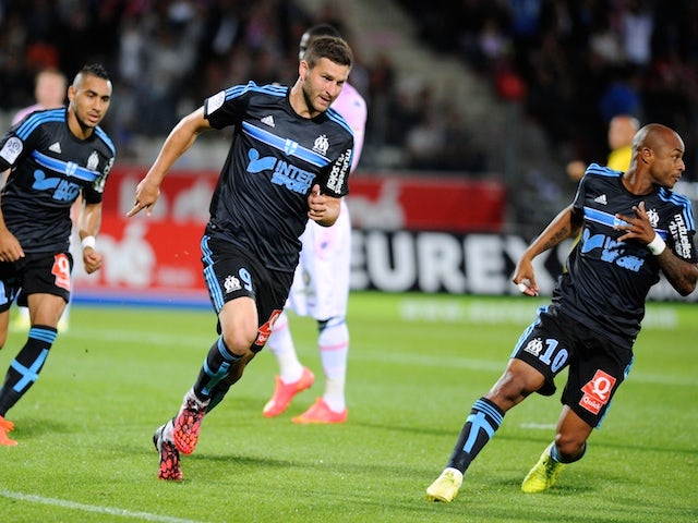 Marseille's French forward Andre-Pierre Gignac (C) celebrates after scoring a goal during the French L1 football match Evian (ETG) against Marseille (OM) on September 14, 2014