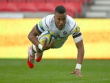 Anthony Watson of Bath Rugby dives over the line to score his teams first try during the Aviva Premiership match against Sale Sharks on September 5, 2014