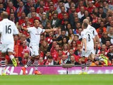 Gabriel Agbonlahor of Aston Villa celebrates scoring the opening goal during the Barclays Premier League match between Liverpool and Aston Villa at Anfield on September 13, 2014