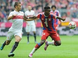 Bayern Munich's Austrian defender David Alaba and Stuttgart's midfielder Moritz Leitner vie for the ball during the German first division Bundesliga football match FC Bayern Munich vs VfB Stuttgart in Munich, southern Germany on September 13, 2014