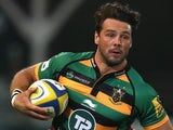 Ben Foden of Northampton runs with the ball during the Aviva Premiership match between Northampton Saints and Gloucester on September 5, 2014