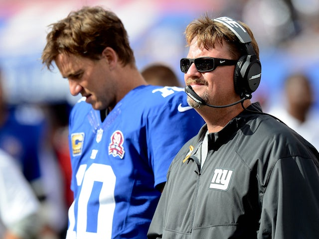 Offensive coordinator Ben McAdoo and quarterback Eli Manning #10 of the New York Giants look on from the sideline against the Arizona Cardinals on September 14, 2014