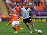 David Perkins of Blackpool in action with Richard Stearman of Wolverhampton Wanderers during the Sky Bet Championship match between Blackpool and Wolverhampton Wanderers at Bloomfield Road on September 13, 2014