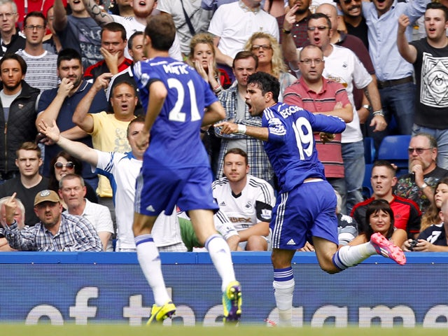 Chelseas Brazilian-born Spanish striker Diego Costa celebrates scoring a goal during the English Premier League football match between Chelsea and Swansea City at Stamford Bridge in London on September 13, 2014