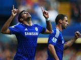 Diego Costa of Chelsea celebrates alongside Branislav Ivanovic as he scores their second goal during the Barclays Premier League match between Chelsea and Swansea City at Stamford Bridge on September 13, 2014