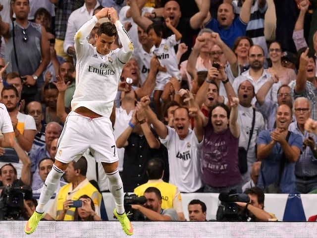 Real Madrid's Portuguese forward Cristiano Ronaldo celebrates after scoring during the Spanish league football match Real Madrid CF vs Club Atletico de Madrid on September 13, 2014