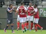 Reims' French forward David N'Gog (2nd R) celebrates with teammates after scoring during the French Ligue 1 football match between Reims and Toulouse, on September 13, 2014