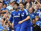 Chelsea's Brazilian-born Spanish striker Diego Costa (R) celebrates scoring with teammate Serbian midfielder Nemanja Matic during the English Premier League football match against Swansea on September 13, 2014