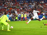 Danny Welbeck of England shoots past goalkeeper Yann Sommer of Switzerland to score their first goal during the UEFA EURO 2016 Group E qualifying match between Switzerland and England at St Jakob-Park on September 8, 2014