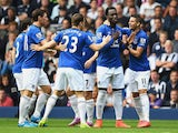 Romelu Lukaku of Everton celebrates scoring the opening goal with team mates during the Barclays Premier League match between West Bromwich Albion and Everton at The Hawthorns on September 13, 2014