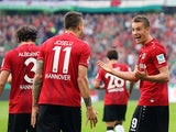 Hannover's Polish striker Artur Sobiech celebrates scoring his team's second goal with Hannover's Spanish striker Joselu during the German first division Bundesliga football match Hannover 96 vs Hamburger SV on September 14, 2014