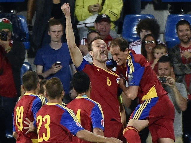 Andorra's defender Ildefons Lima (C) celebrates with teammates after scoring a goal during the Euro 2016 qualifying round football match Andorra against Wales on September 09, 2014