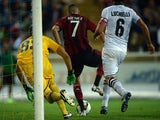 AC Milan's French forward Jeremy Menez (C) scores during the Serie A football match Parma vs AC Milan at Parma's Ennio Tardini Stadium on September 14, 2014