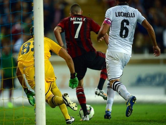 AC Milan's French forward Jeremy Menez (C) scores during the Serie A football match Parma vs AC Milan at Parma's Ennio Tardini Stadium on September 14, 2014