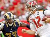 Josh McCown #12 of the Tampa Bay Buccaneers rushes for a touchdown as E.J. Gaines #33 of the St. Louis Rams defends during a game on September 14, 2014