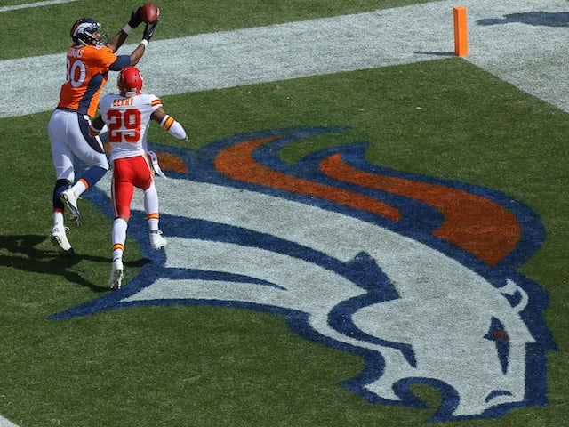 Tight end Julius Thomas #80 of the Denver Broncos pulls in a touchdown against the Kansas City Chiefs on September 14, 2014